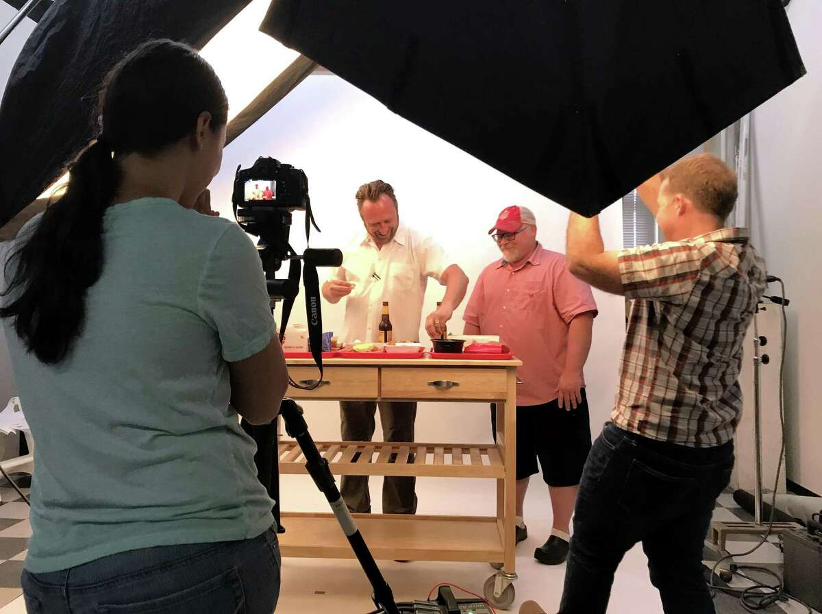San Antonio chefs Stefan Bowers (left) and Jeff White judge a selection of fast food items in the Express-News photo studio.