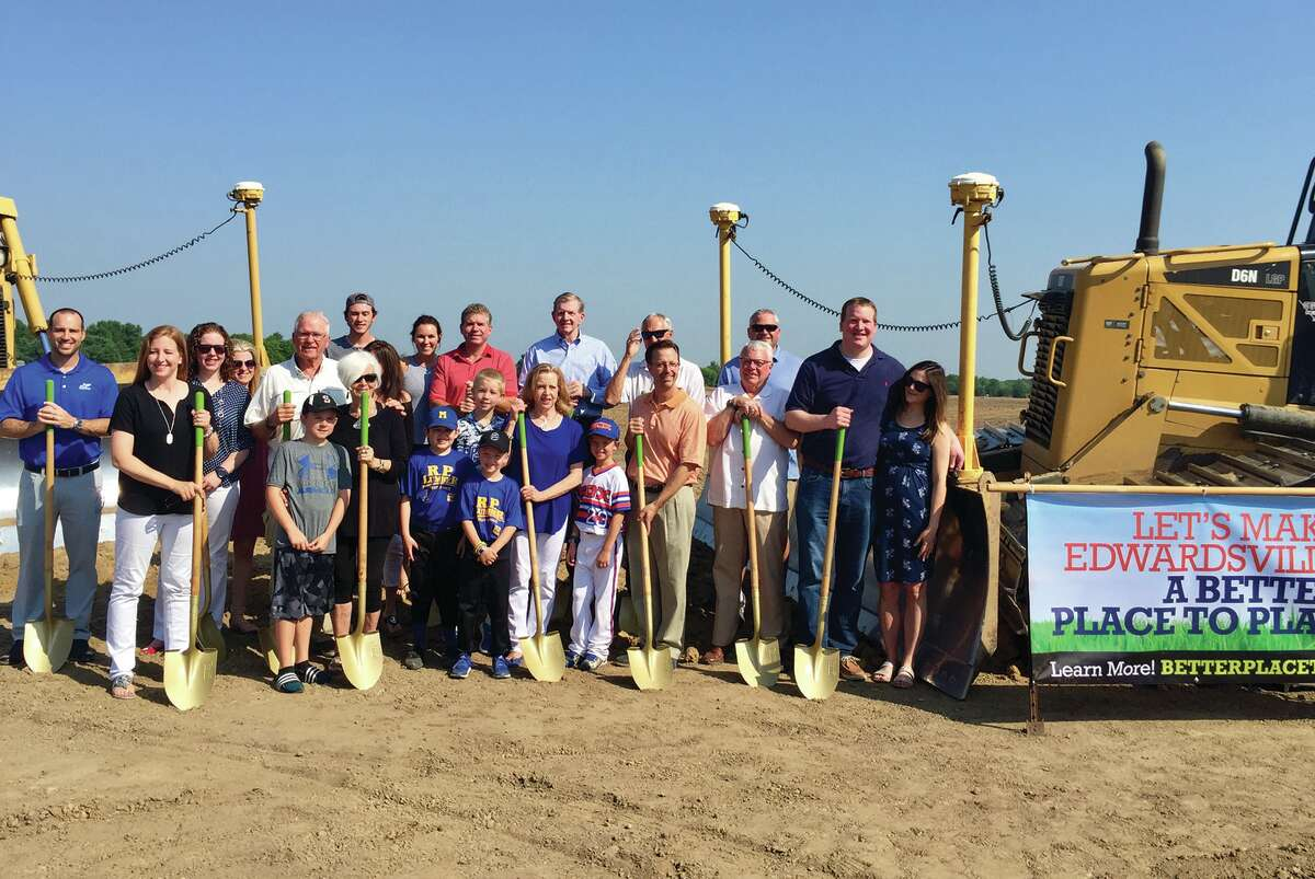 Members of the Plummer family, city officials and young area athletes gather Saturday morning for a groundbreaking ceremony at the Plummer Family Park.