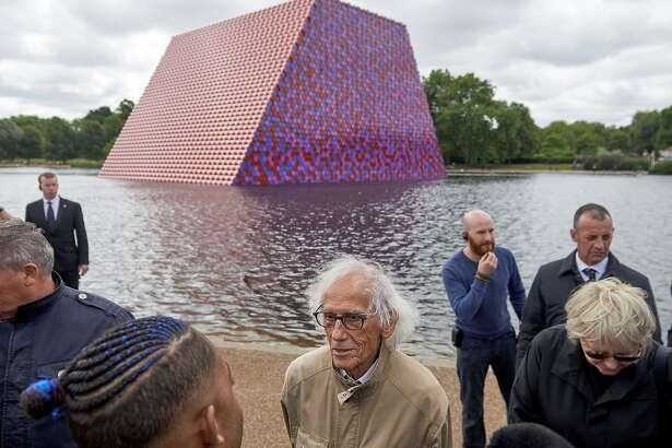 Bulgarian artist Christo Vladimirov Javacheff, better known as 'Christo', speaks as he unveils his artwork, 'The Mastaba' on the Serpentine lake in Hyde Park in London on June 18, 2018. Christo's first UK outdoor work is a 20m high installation made from over 7000 coloured, horizontally stacked barrels on a floating platform. / AFP PHOTO / NIKLAS HALLE'N / RESTRICTED TO EDITORIAL USE - MANDATORY MENTION OF THE ARTIST UPON PUBLICATION - TO ILLUSTRATE THE EVENT AS SPECIFIED IN THE CAPTIONNIKLAS HALLE'N/AFP/Getty Images
