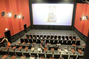Workers clean a theater at the Alamo Drafthouse Cinema - LaCenterra during a pre-opening media tour, Katy, TX on Wednesday, June 12, 2018.