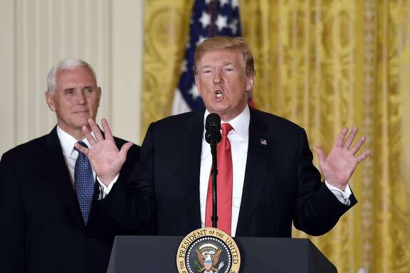 President Donald Trump speaks as Vice President Mike Pence looks on during a meeting with the National Space Council on Monday, June 18, 2018 in the East Room of the White House, in Washington, D.C. (Olivier Douliery/Abaca Press/TNS)