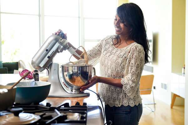 Just Date Syrup creator Sylvie Charles uses a mixer while making tahini-date chocolate chip cookies at her home in San Francisco, Calif., on Tuesday June 12, 2018.