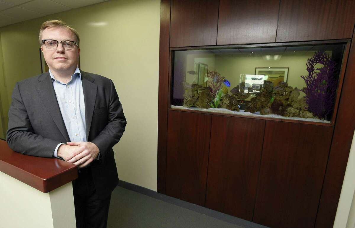 Greg Wood, founder and CEO of Stamford-based technology consulting firm GIBC Digital, poses for a photo in the firm's offices at 243 Tresser Blvd., in Stamford, Conn.