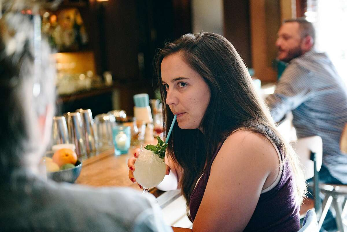 Charlotte Eilbert of San Francisco sips her Matilda Bay cocktail through a paper straw at Horsefeather bar in San Francisco, Calif., on Tuesday June 12, 2018.