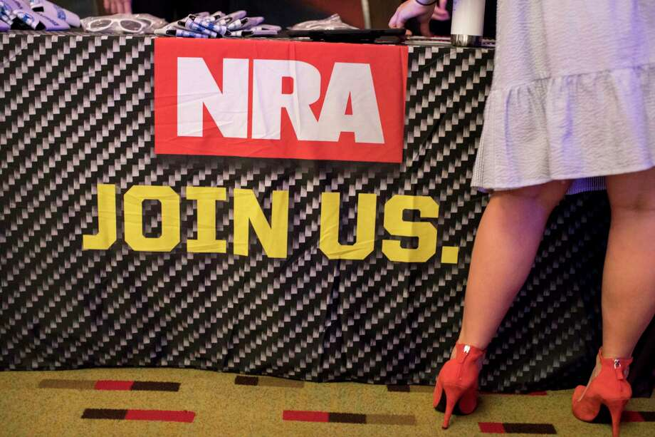 """An NRA recruitment poster at the Young Women's Leadership Summit, a conference organized by Turning Point USA and sponsored by the NRA, in Dallas, June 14, 2018. An estimated 1,000 young women took part in sessions like """"How Political Correctness is Making Everyone Stupid"""" and displayed enthusiasm they hope to see for Republicans in the midterm elections. (Ilana Panich-Linsman/The New York Times) Photo: ILANA PANICH-LINSMAN, NYT / NYTNS"""