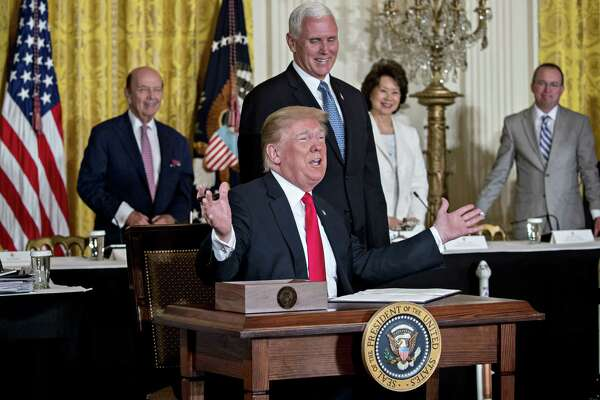 President Donald Trump speaks before signing the Space Policy Directive-3 next to U.S. Vice President Mike Pence, during a National Space Council meeting in the East Room of the White House in Washington on Monday, June 18.
