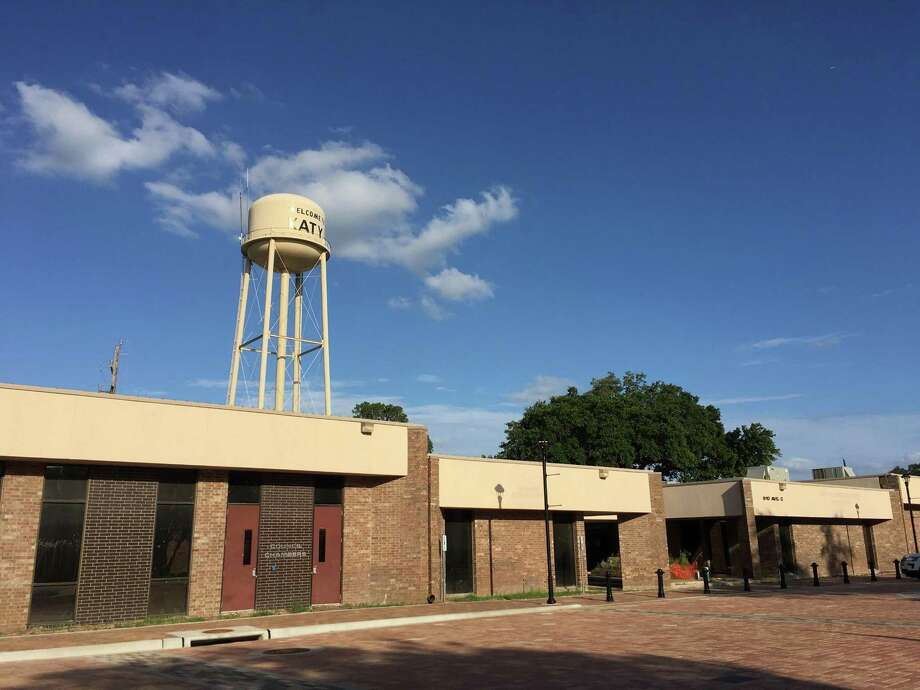 The administrative offices on the right of the former city council chambers will be demolished to create green space for the Katy Town Square. The water tower, with ground tanks removed, will be surrounded by an outdoor museum and green space. Photo: Karen Zurawski / Karen Zurawski