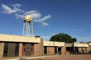 The administrative offices on the right of the former city council chambers will be demolished to create green space for the Katy Town Square. The water tower, with ground tanks removed, will be surrounded by an outdoor museum and green space.