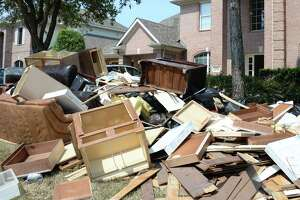 Furniture and other items sit on the curb after being removed from a flood damaged home in Cinco Ranch near near Creech Elementary School in Katy, TX on September 6, 2017.