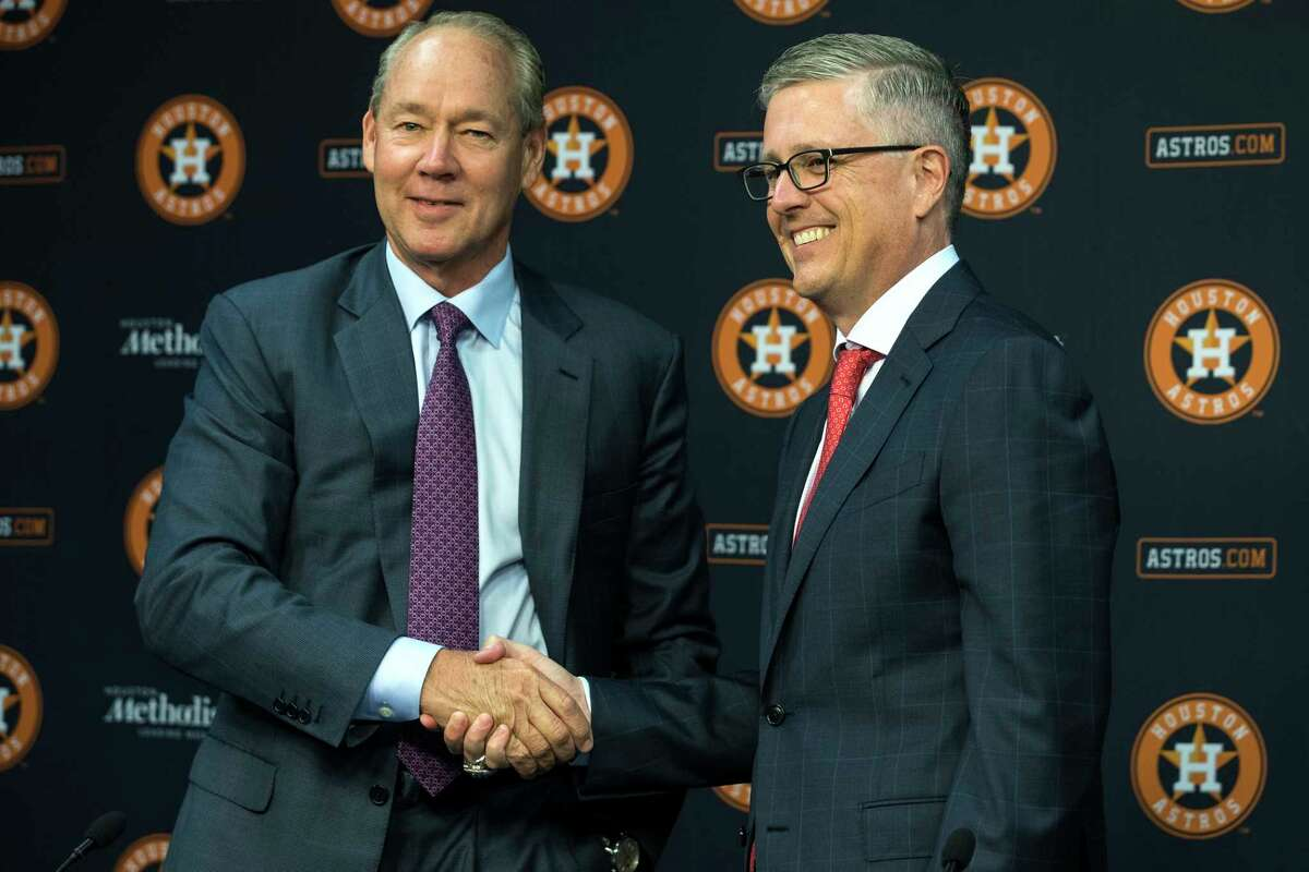 The Astros were the defendant in numerous lawsuits in the wake of their sign-stealing scandal, with the most notable filed by former general manager Jeff Luhnow (right), pictured here with owner Jim Crane during happier times.