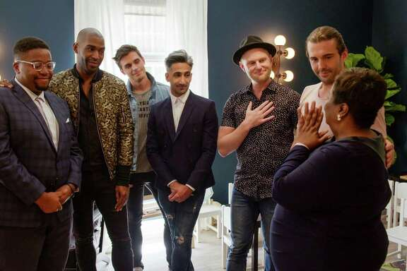 "Myles Hicks, Karamo Brown, Antoni Porowski, Tan France, Bobby Berk, Jonathan Van Ness and Tammye Hicks in the Netflix series ""Queer Eye."""