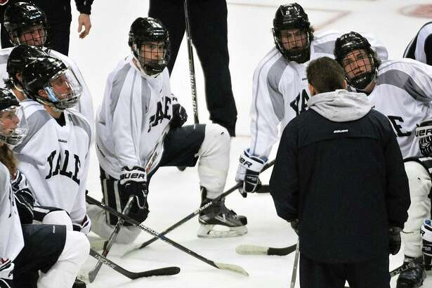Yale hockey coach Keith Allain talks to players during the 2016 NCAA regionals.