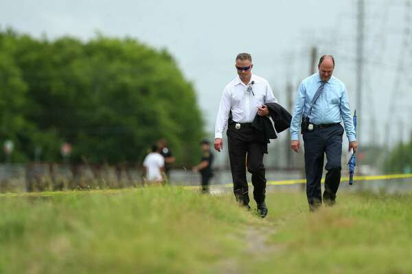 Authorities investigate the scene where a man was fatally shot, his body was found in Keegans Bayou near the 9000 block of Willow Meadow Drive Monday, June 18, 2018, in Houston.