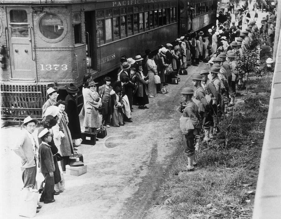 American troops supervise the movement of Japanese Americans from their homes on the American west coast to ten specially built camps after Japanese's attack on Pearl Harbour during World War II. Photo: Hulton Deutsch/Corbis Via Getty Images