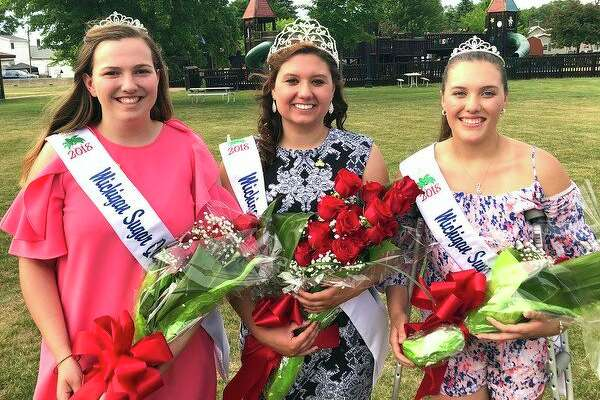 The 2018 Michigan Sugar Queen and Court: from left,Second Attendant Ashley Gibbs of Almont, Michigan Sugar Queen Paige Lupcke of Saginaw, andFirstAttendant Rachel Phillips of Almont.
