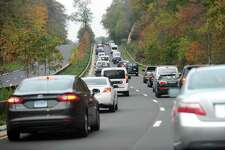 FILE PHOTO —Traffic moves slowly in the southbound lanes of the Merritt Parkway, towards, Greenwich, following a fatal accident involving a tractor trailer and car in Stamford, Conn. on Thursday, Nov. 2, 2017.