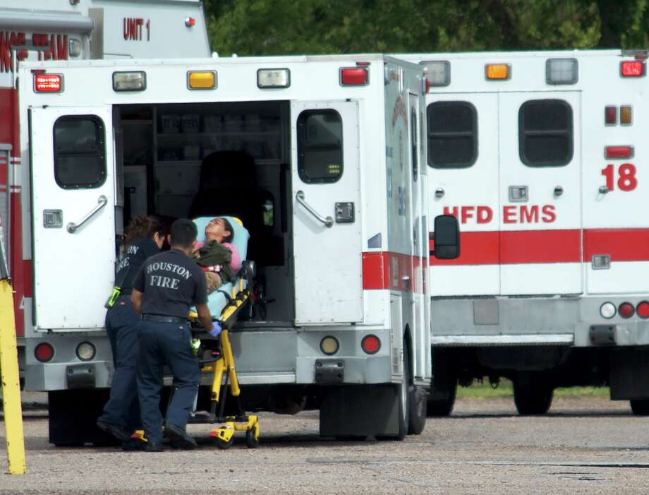 "A woman is placed in the back of an ambulance after a ""carbon monoxide incident"" at a business in the 3100 block of Produce Row in southeast Houston on Monday, June 18, 2018. Photo: Jay R. Jordan"