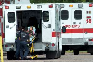 """A woman is placed in the back of an ambulance after a """"carbon monoxide incident"""" at a business in the 3100 block of Produce Row in southeast Houston on Monday, June 18, 2018."""