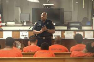 Harris County Sheriff's Deputy D. Walker speaks to defendants on Dec. 19, 2017, before a probable cause hearing in Houston.
