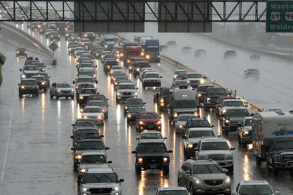Traffic slows on Interstate 10 during Monday's rain. Parts of Southeast Texas are expected to receive one to two inches of rain over the next couple of days, the National Weather Service in Lake Charles said Monday. Photo taken Monday, 6/18/18