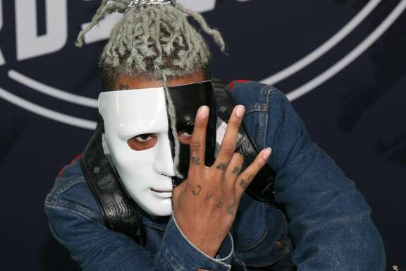 MIAMI BEACH, FL - OCTOBER 06:  Rapper XXXTentacion attends the BET Hip Hop Awards 2017 at The Fillmore Miami Beach at the Jackie Gleason Theater on October 6, 2017 in Miami Beach, Florida.  (Photo by Bennett Raglin/Getty Images for BET  )