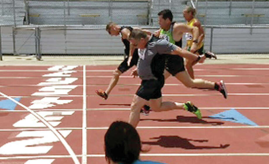 Mike Young of Wood River finishes first in the 200-meter run at the recent Missouri Senior Games in Columbia , Mo.