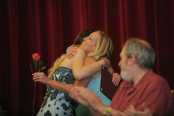 Jessalyn Couch gets a hug from Julie Santorella after receiving her diploma during the Stamford Public Schools' Alternative Routes to Success graduation inside the auditorium at Stamford High School in Stamford, Conn. on Monday, June 18, 2018.