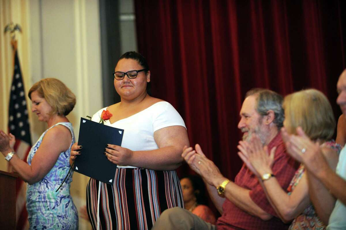 Jazmin Gonzalez gets a rousing ovation after receiving her diploma during the Stamford Public Schools' Alternative Routes to Success graduation inside the auditorium at Stamford High School in Stamford, Conn. on Monday, June 18, 2018.