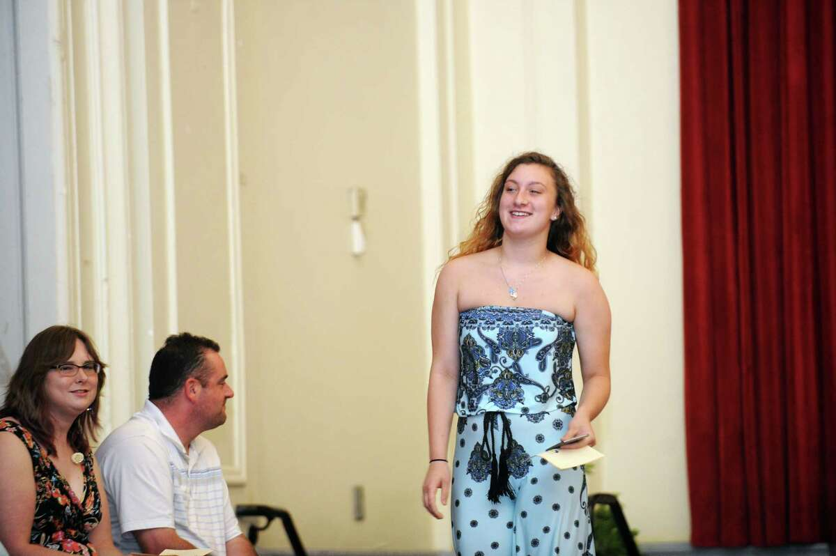 Jessalyn Couch receives the citizenship award during the Stamford Public Schools' Alternative Routes to Success graduation inside the auditorium at Stamford High School in Stamford, Conn. on Monday, June 18, 2018.
