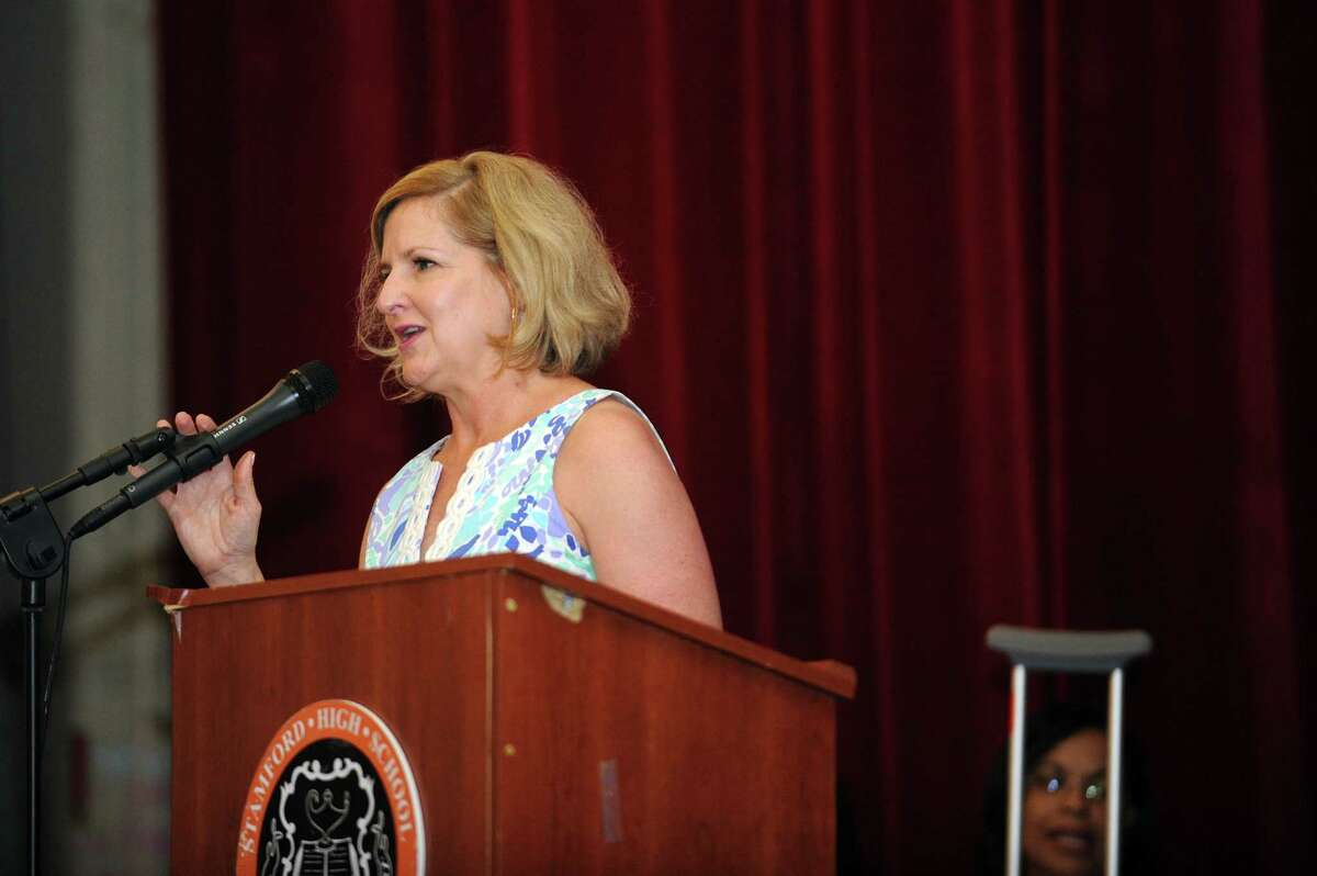 Dr. Laura Greene, the assistant director of alternative programs, speaks during the Stamford Public Schools' Alternative Routes to Success graduation inside the auditorium at Stamford High School in Stamford, Conn. on Monday, June 18, 2018.