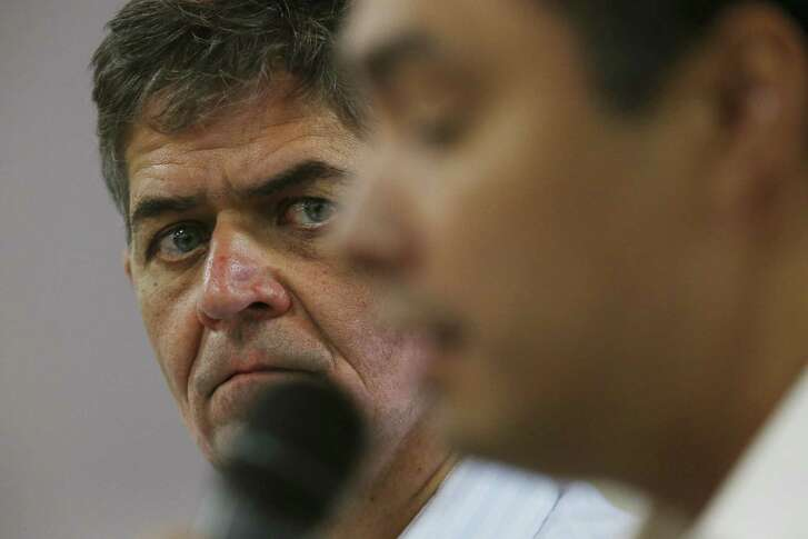 """U.S. Congress member Filemon Vela, Jr., (D-Harlingen), looks at Rep. Joaquin Castro, (D-San Antonio), during an immigration press briefing in Brownsville, Texas, Monday, June 18, 2018. Earlier in the day, six Democratic congress members visited two immigration shelters holding minor migrants. Some of them are the results of the President Donald Trump's """"Zero-tolerance"""" policy."""