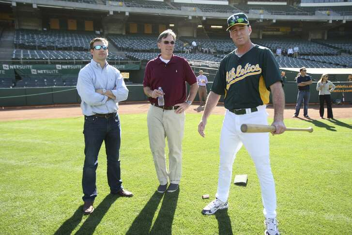 General Manager Billy Beane of the Oakland Athletics watches with Manager Bob Melvin #6 and Assistant General Manager David Forst as Addison Russell works out at the Oakland-Alameda County Coliseum on June 15, 2012 in Oakland, California. Russell was selected as the Athletics first pick in the 2012 MLB Draft