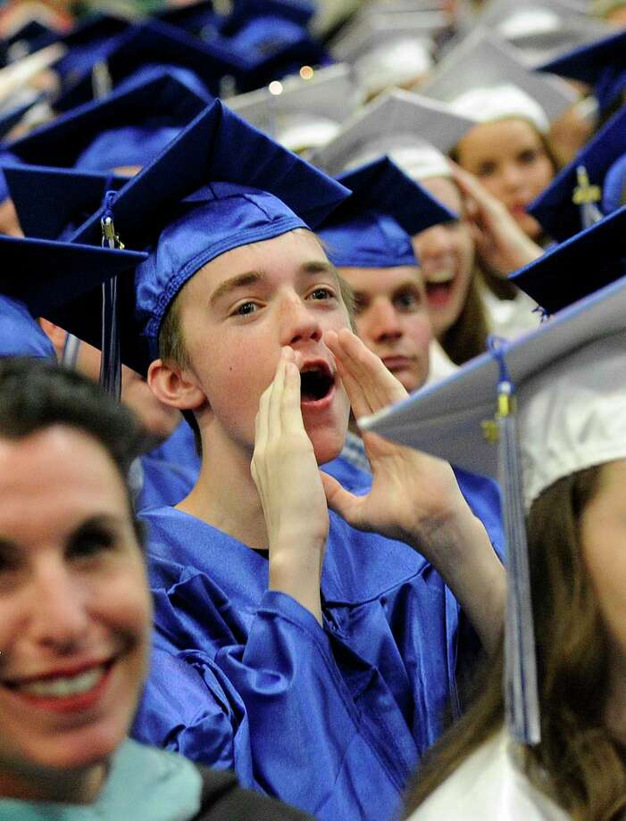 Danny Arneth calls out to his friend at Newtown High School graduation  ceremony held at the O'Neill Center at Western Connecticut State University Monday, June 18, 2018. Photo: Carol Kaliff, Hearst Connecticut Media / The News-Times
