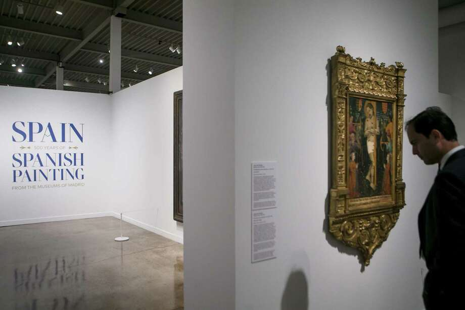 A visitor looks at art in the new collection at the San Antonio Museum of Art before the arrival of King Felipe VI and Queen Letizia of Spain June 18, 2018. Photo: Josie Norris, Staff / San Antonio Express-News / © San Antonio Express-News