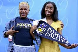 Sonia Rochester (left) celebrates with her daughter, Nia Anderson, who announced she will attend Pomona College in the fall during Senior Signing Day at Achievement First Amistad High School in New Haven on May 24, 2018.