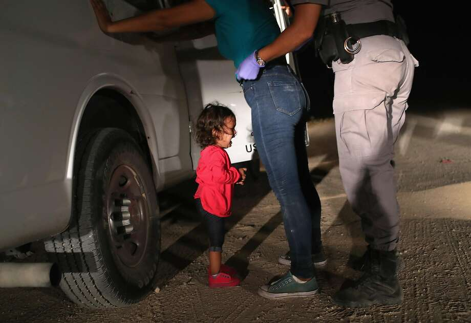 "An image of a girl crying at the foot of her mother and border patrol agents led Charlotte and Dave Willner's fundraising RAICES campaign to ""Reunite an immigrant parent with their child."" Photo: John Moore, Getty Images"
