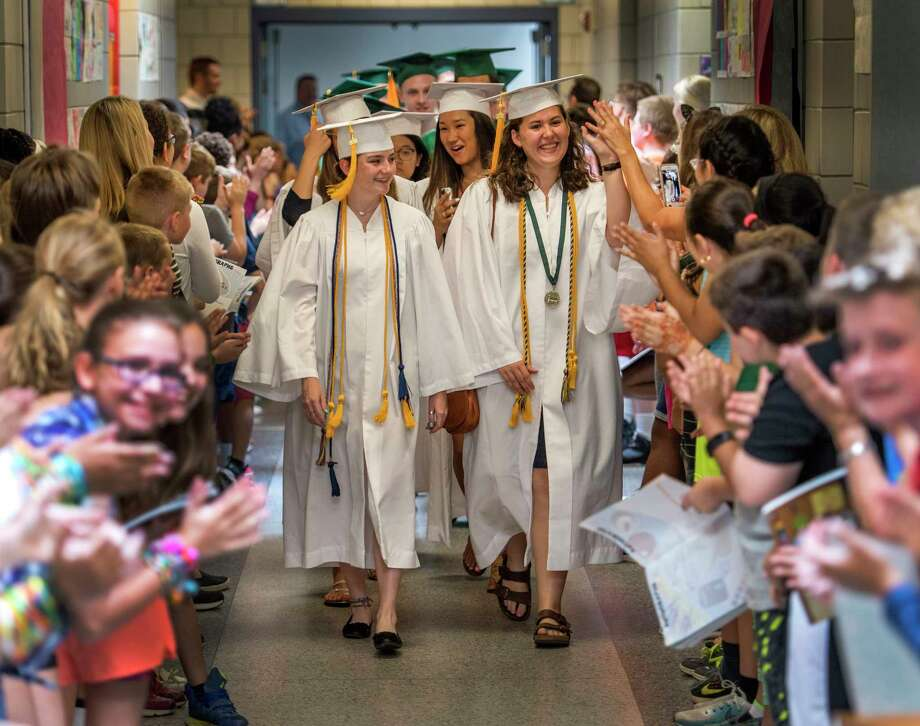 """Shenendehowa High School seniors walk the halls of Arongen Elementary School during the Graduate Walkthrough program to meet and greet the Class of 18"""" otherwise known as moving up class of fifth graders Monday June 18, 2018 in Clifton Park, N.Y. The Graduate Walkthrough program gives the elementary school students a feel for what they have to look forward to and the high school seniors a chance to see their former teachers.   (Skip Dickstein/Times Union) Photo: SKIP DICKSTEIN / 20044134A"""