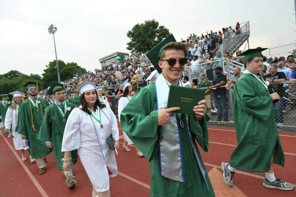 The Norwalk High School class of 2018 graduates during commencement exercises on Monday June 19, 2018 in Norwalk Conn