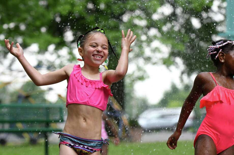 Jaeleesa Edmonds, 7, of Troy, left, and Indira Dinkins, 6, right, cool off on the splash pad at Frear Park on Monday, June 18, 2018, in Troy, N.Y.  (Will Waldron/Times Union) Photo: Will Waldron / 20044135A