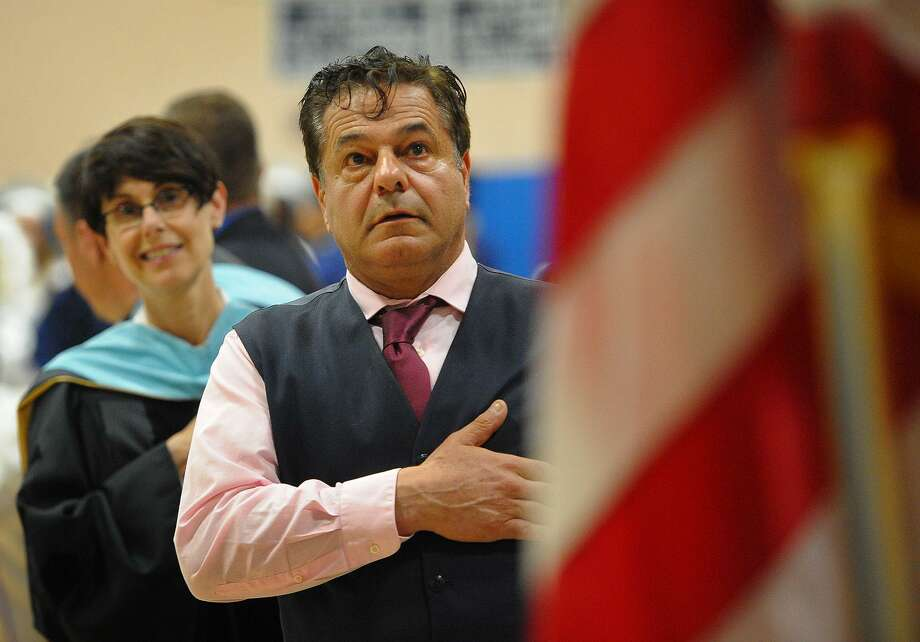 Ansonia Superintendent of Schools Carol Merlone, left, and Mayor David Cassetti during the singing of the National Anthem at the Ansonia High School Commencement on Monday. Photo: Brian A. Pounds / Hearst Connecticut Media / Connecticut Post
