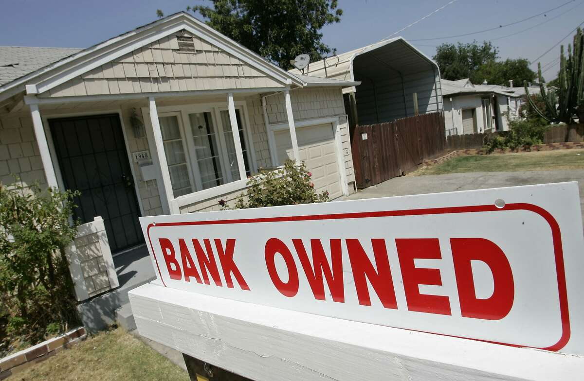 FILE-- A sign of a house under foreclosure is shown in Antioch, Calif., Thursday, Aug. 14, 2008. Wells Fargo agreed Wednesday to pay a $2.1 billion fine to settle allegations it misrepresented the types of mortgages it sold to investors during the housing bubble that ultimately led to the 2008 financial crisis.