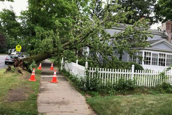 A severe thunderstorm hit Saratoga Springs at around 4 p.m. Monday, June 18, 2018. Trees are down on Lake Avenue. (David Johnson / Times Union) IMAGE 1 OF 47 A severe thunderstorm hit Saratoga Springs at around 4 p.m. Monday, June 18, 2018. Trees are down on Lake Avenue. (David Johnson / Times Union)