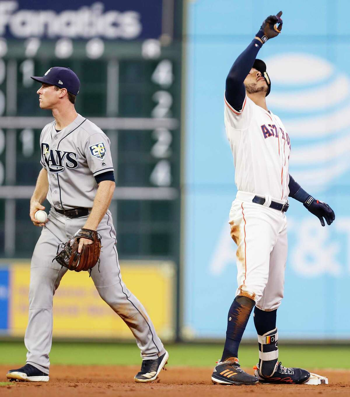 Houston Astros shortstop Carlos Correa (1) reacts after sliding into secdon ahead of the tag by Tampa Bay Rays second baseman Joey Wendle for a double during the fourth inning of a major league baseball game at Minute Maid Park on Monday, June 18, 2018, in Houston.