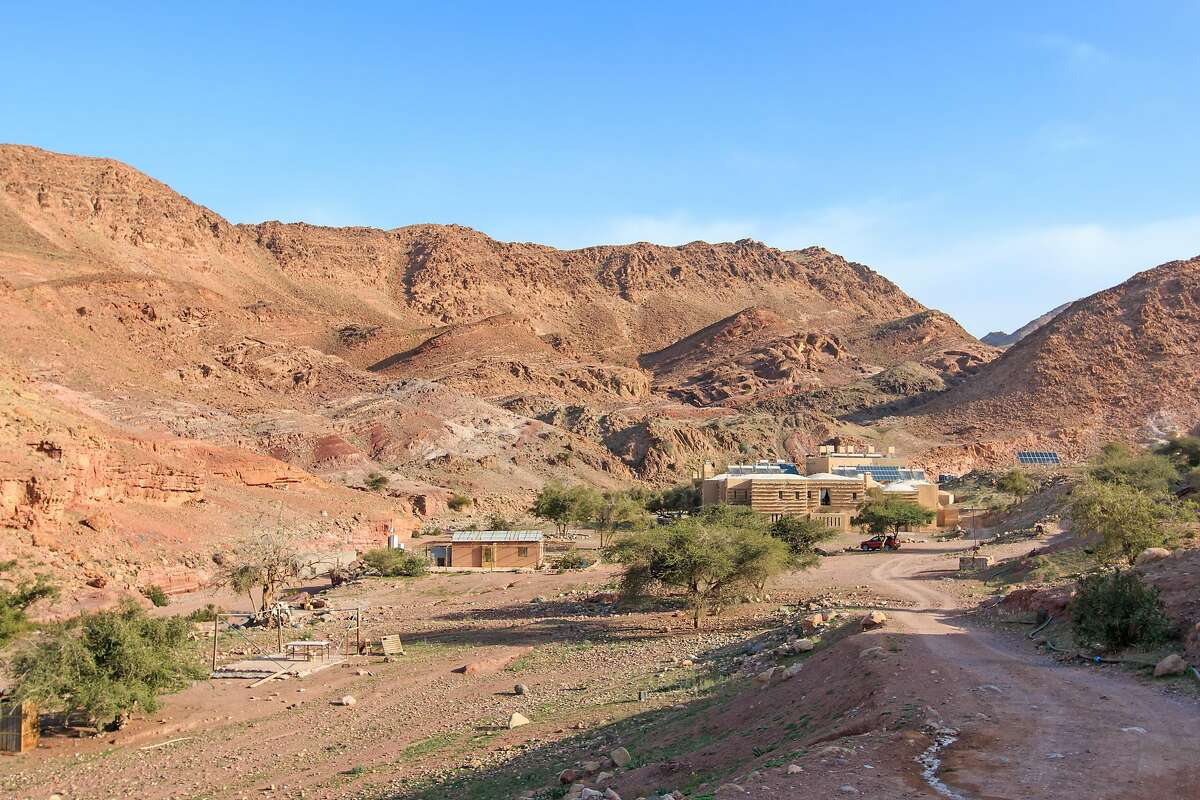 The sun rises over Feynan Ecolodge, which was designed to operate in harmony with its habitat in the Dana Biosphere Reserve��in Jordan, and to minimize the impact of tourism on the surrounding natural environment.