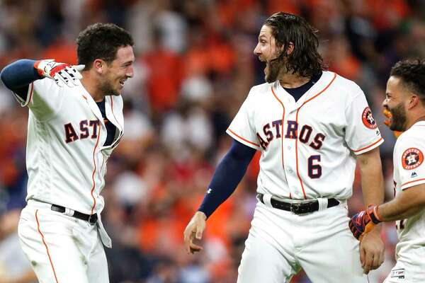 Houston Astros third baseman Alex Bregman, left, Jake Marisnick (6) and Jose Altue celebrate Bregman's walkoff 2 RBI double against the Tampa Bay Rays during the ninth inning of a major league baseball game at Minute Maid Park on Monday, June 18, 2018, in Houston. The Astros came from behind to beat the Rays 5-4.