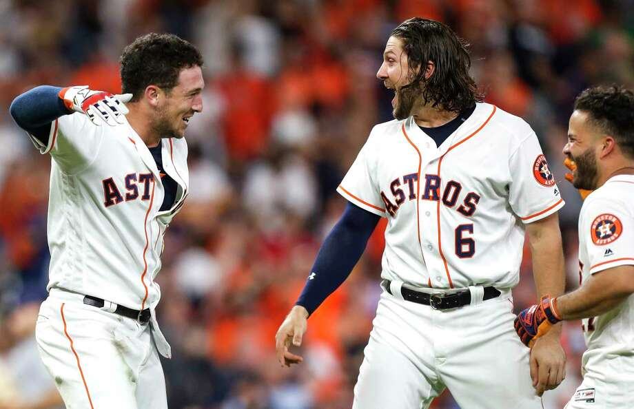 Houston Astros third baseman Alex Bregman, left, Jake Marisnick (6) and Jose Altue celebrate Bregman's walkoff 2 RBI double against the Tampa Bay Rays during the ninth inning of a major league baseball game at Minute Maid Park on Monday, June 18, 2018, in Houston. The Astros came from behind to beat the Rays 5-4. Photo: Brett Coomer, Houston Chronicle / © 2018 Houston Chronicle