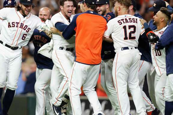 Houston Astros third baseman Alex Bregman, center, celebrates his walkoff 2 RBI double against the Tampa Bay Rays during the ninth inning of a major league baseball game at Minute Maid Park on Monday, June 18, 2018, in Houston. The Astros came from behind to beat the Rays 5-4.