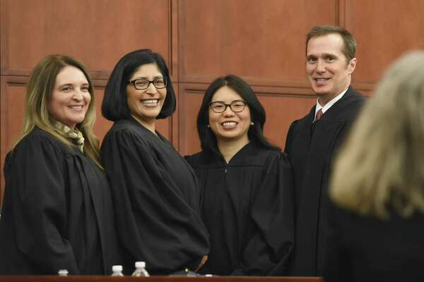 U.S. district judges Marina Garcia Marmolejo and Diana Saldaña and U.S. magistrate judges Diana Song Quiroga and John Kazen gather for a photo after he was sworn in as the newest magistrate judge on Monday at the federal courthouse in Laredo.