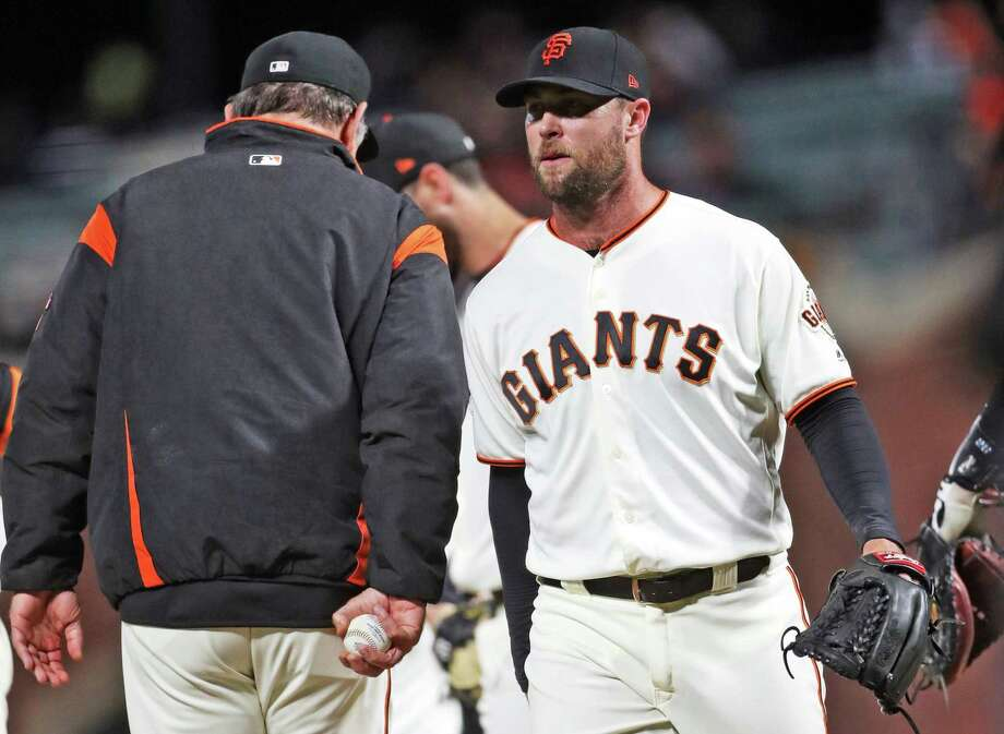 San Francisco Giants' Hunter Strickland is removed from the game by manager Bruce Bochy after giving up 3 runs and a 4-2 lead in 9th inning against Miami Marlins during MLB game at AT&T Park in San Francisco, Calif. on Monday, June18, 2018. Photo: Scott Strazzante / The Chronicle / San Francisco Chronicle