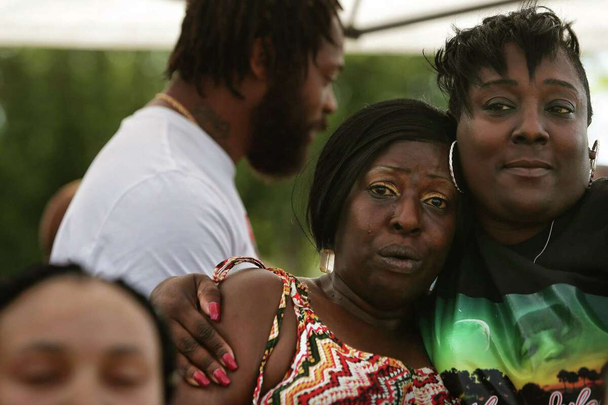 Tonya Isabell and Katrina Johnson, cousins of Charleena Lyles, comfort each other during a remembrance event on the one-year anniversary of her death, Tuesday, June 18, 2018 at Magnuson Park. Lyles was killed one year ago by Seattle Police officers in her apartment after she called them for assistance.